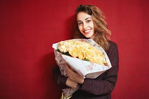 happy beautiful woman with a bouquet of roses
