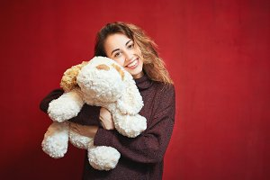 happy beautiful woman with a toy dog