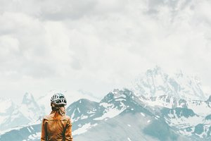 Woman traveler hiking in mountains