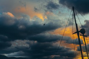Mast Of Sailing Yacht Against Dramatic Clouds. Danger Adventure Travel Concept