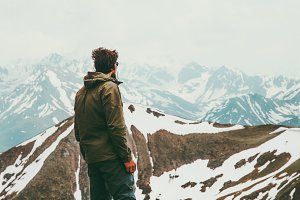 Man traveler alone wander mountains