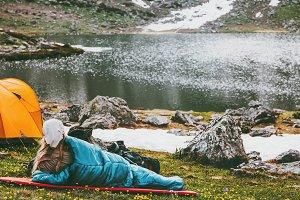 Woman relaxing in sleeping bag