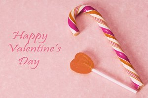 valentines greeting card with rubber candies and chupachups