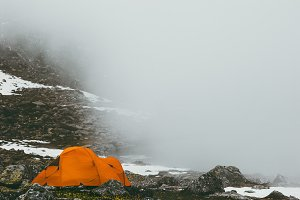 Camping tent in foggy Mountains