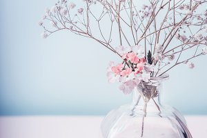 Jar with pink lotion and flowers
