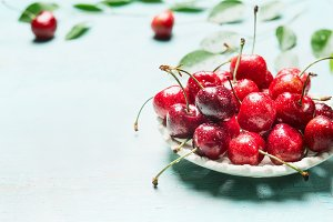 Bowl with fresh red cherry berries