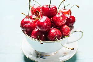 Cup with fresh ripe cherry berries