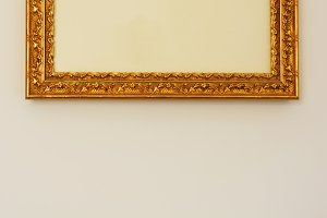 detail of a golden decorated frame