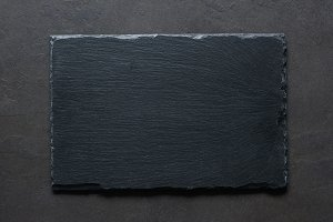 Black slate background top view