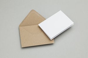 Blank white card with brown envelope