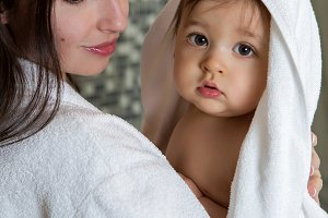mother in a Bathrobe and with a child