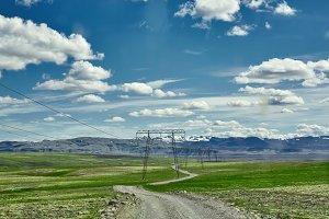 road in a bright sunny mountain landscape