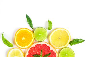 citrus food pattern on white background - assorted citrus fruits with mint leaves. Isolated on white background