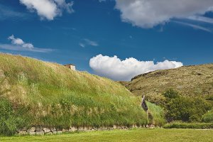Traditional Icelandic houses with grass roof, Iceland. Old architecture with grassy roof.