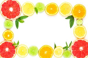 frame with slice of oranges, lemons, limes, grapefruit and mint pattern on white. Flat lay