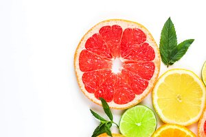 citrus food corner on white background - assorted citrus fruits with mint leaves. Isolated on white background
