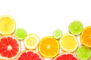top view of slices of citrus fruits isolated on white background