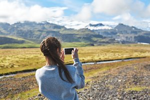 woman getting picture on phone in Iceland
