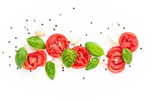 food background of tomato, garlic and basil on white background. Top view