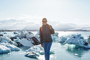 Woman with backpack in Ice Lagoon in Iceland