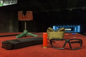 Photo of shooting gallery with glasses, pistol, sleeve