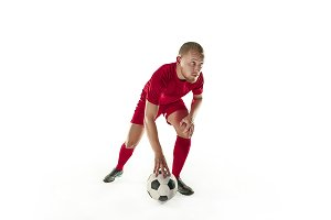 Professional football soccer player with ball isolated white background