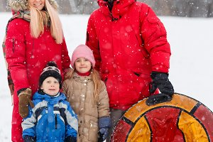 Photo of parents with daughter and son on winter walk