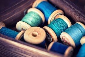 threads in aqua tone