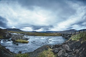 Mountain river in the severe gloomy Icelandic landscape