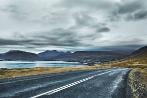 Empty asphalt road in the Icelandic landscape