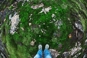 Icelandic landscape, lava field and bright green moss under the feet of the traveler