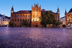 Torun Town Hall And Square At Dusk