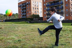 Boy kicking a ball