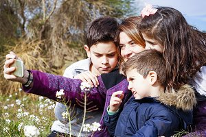 Mother and children taking a selfie