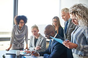 Diverse businesspeople working together at a table in an office
