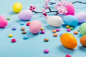 Colorful decorative eggs on spring background