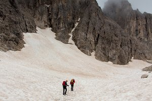 Backpacker hiking in snow field