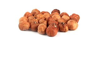 peeled hazelnuts isolated on white background