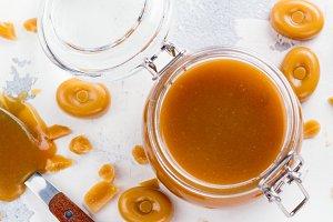 Homemade salted caramel sauce in a glass jar