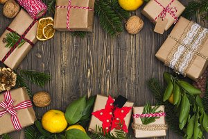 Many Christmas gift boxes on decorated background