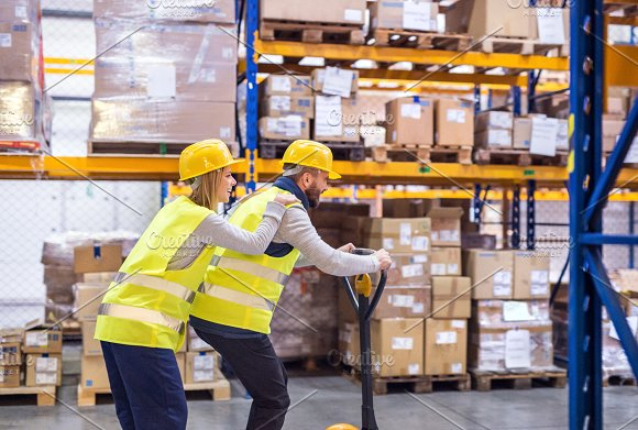 Two young workers in a warehouse. in Graphics