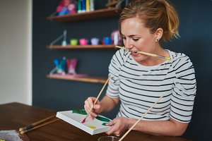 Creative woman painting