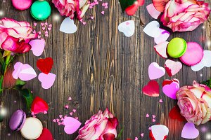 Valentines day background with roses, macaroons and decorative hearts