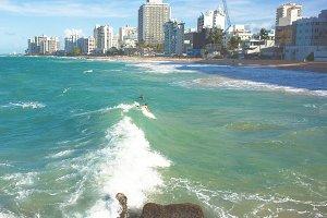 Surfing in San Juan Condado Beach