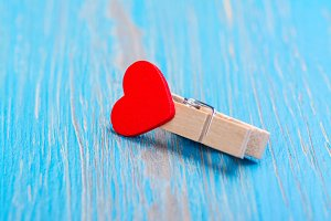 Small wooden clothespin with red heart