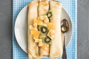 Delicious pancakes with banana, kiwi