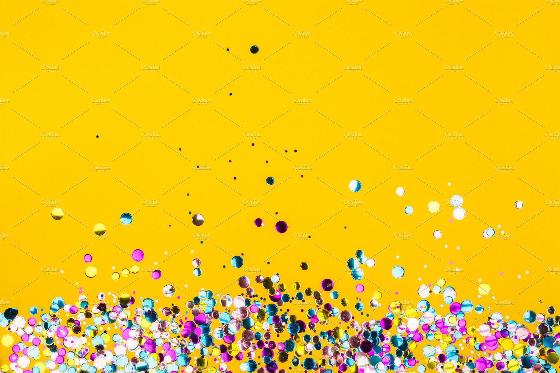 Colorful Confetti On Yellow Background Holiday Photos