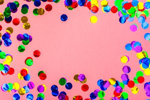 Colorful confetti on pink background