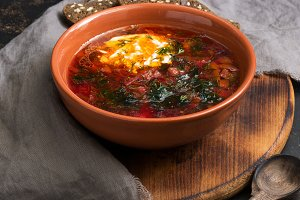Red soup borscht in a rustic style