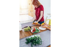 Woman cutting corn prepare food. Cooking salad